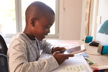 Boy Learning going through reading therapy on computer